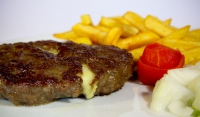 Grilled hamburger filled with cheese